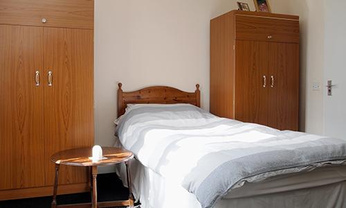 Sheltered, affordable accommodation for older men rye hill bed room